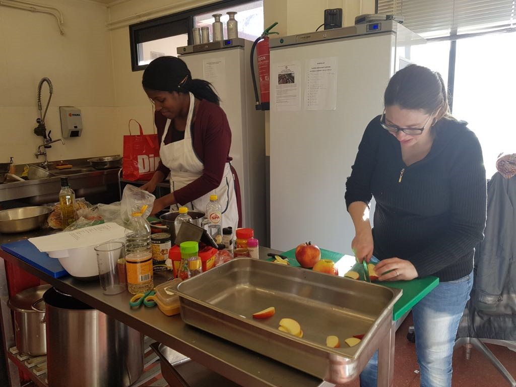 Crown Amsterdam and SACO Apartments employees worked together to provide food for the homeless at Het Stoelenproject
