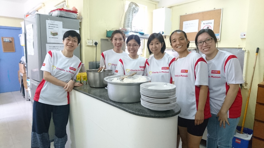 Employees from the Hong Kong team cooking a meal for the Hong Kong Refugee Centre